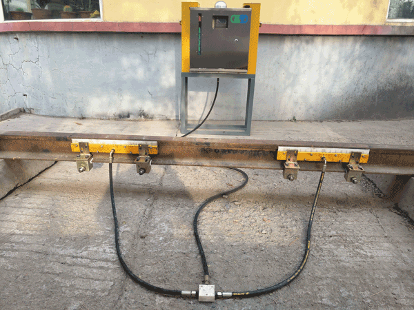 钢轨涂油器
